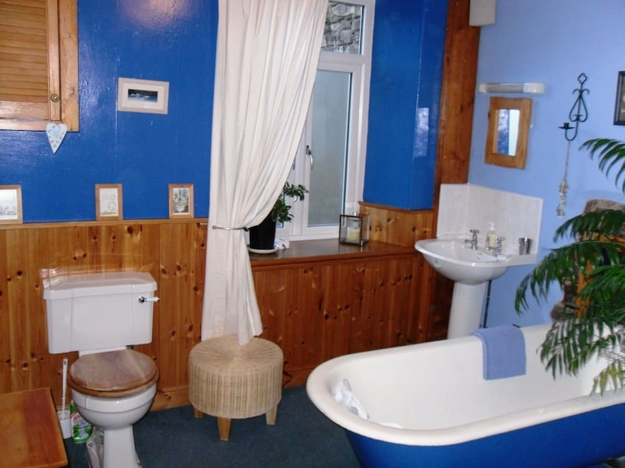 The bathroom with a cast iron bath