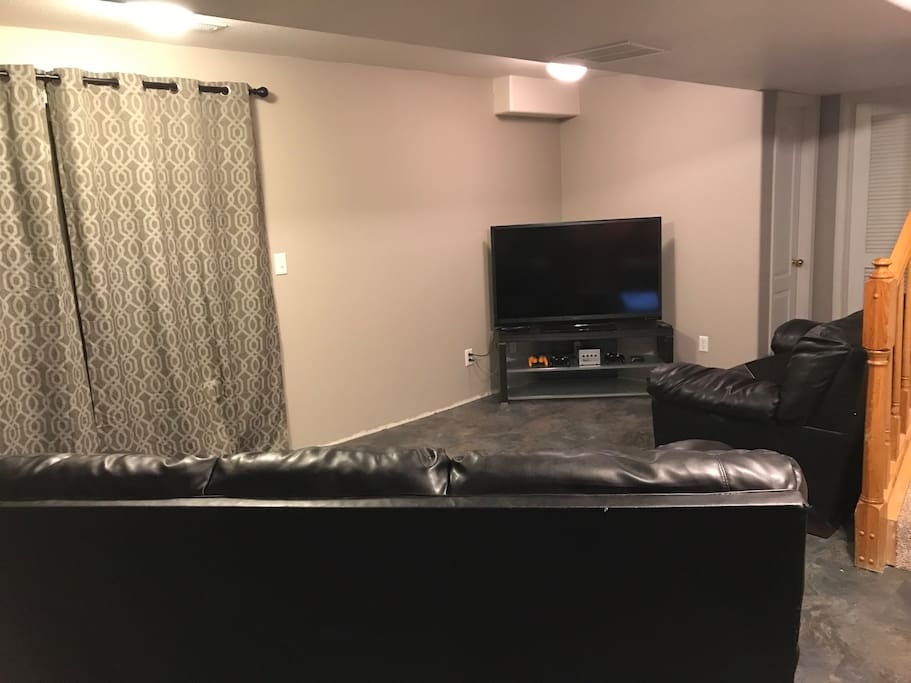 Private living space with couches and TV