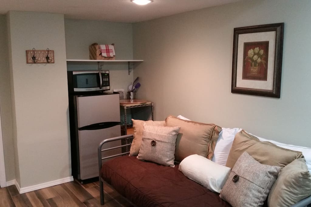 Small executive style kitchenette with fridge, microwave, 3 in 1 toaster/hot plate/coffee machine.