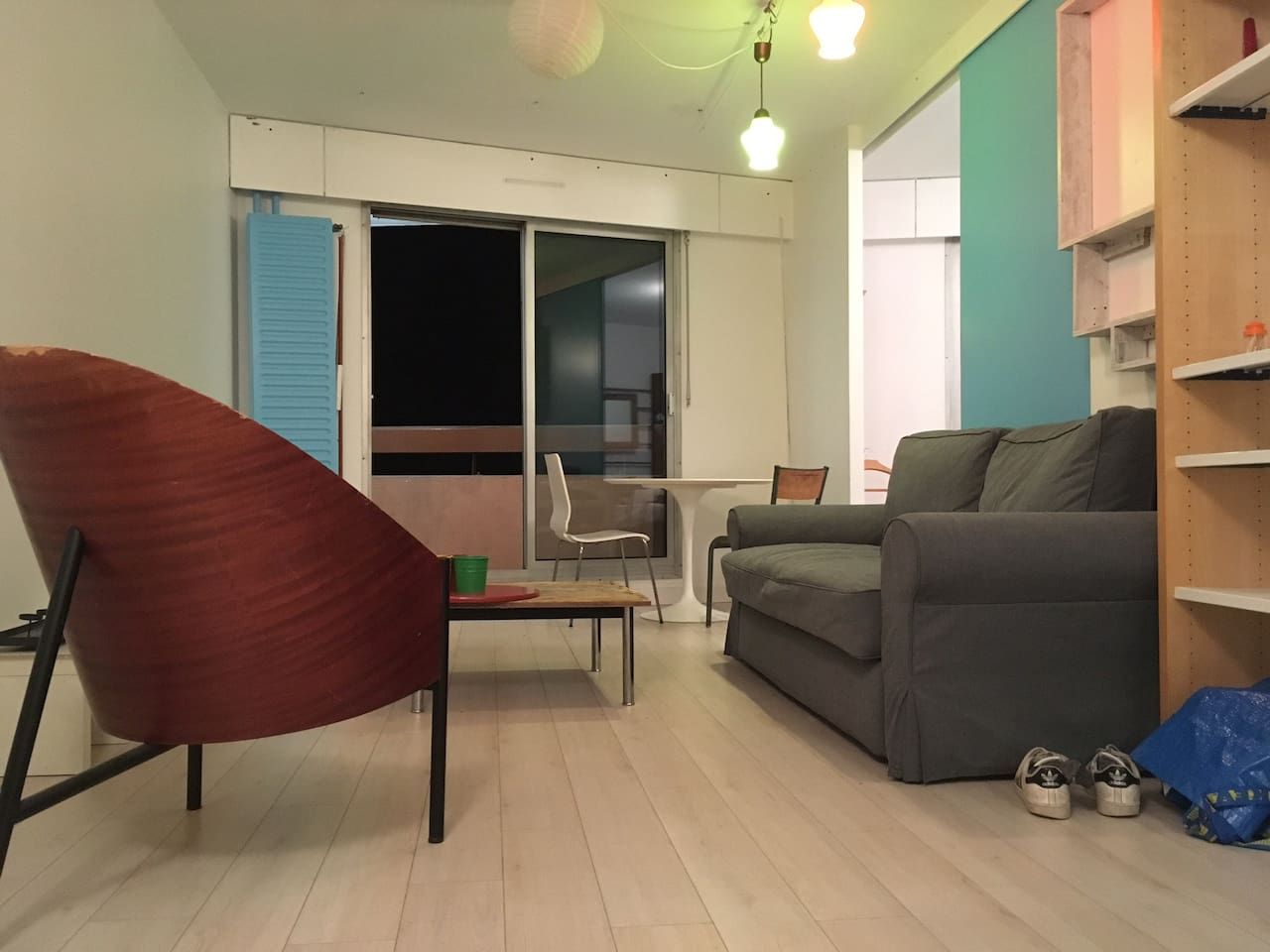 The living room, the part behind the sofa can be totally open or close, to make different kind of atmosphere, like little terrier or big loft,