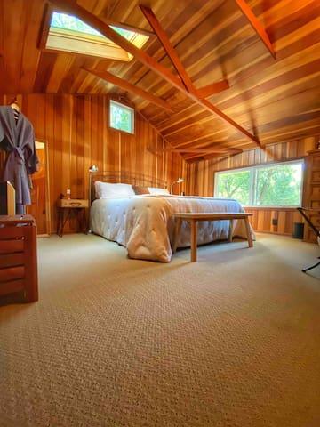 Loft Bedroom #1 w/ Tempur-Pedic (Cal King) bed, organic linen, and robes. (Skylight in bedroom & sleep masks provided).