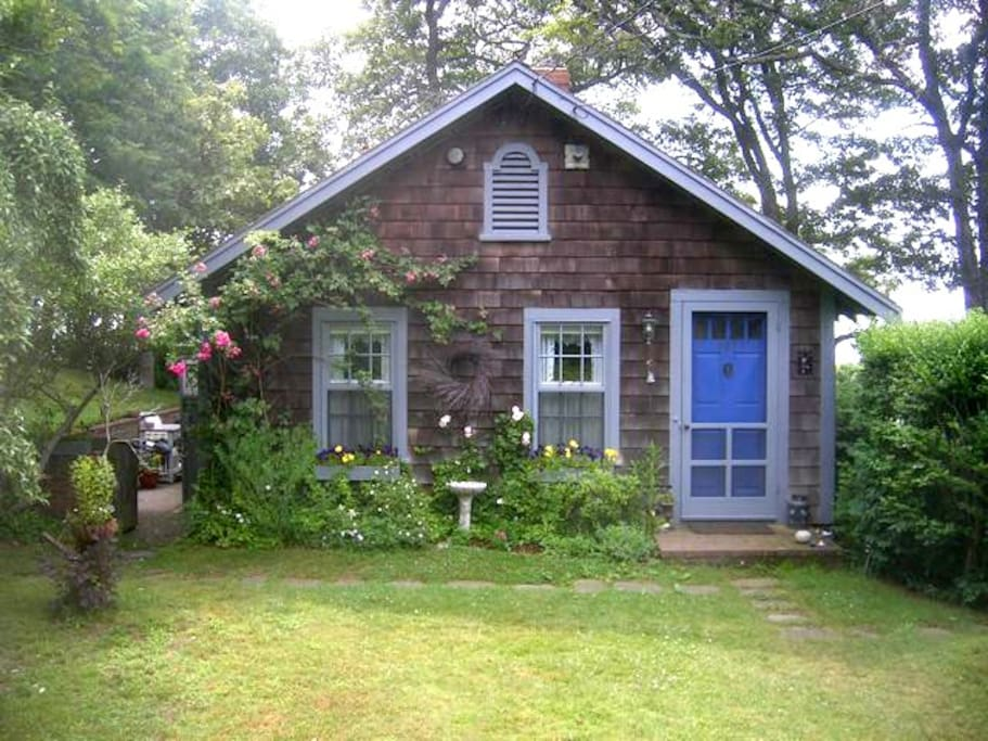 Our charming cottage is tucked atop a rolling lawn