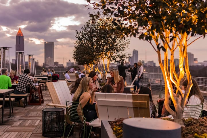 Enjoy craft cocktails and tasty meals around fire pits on Ponce City Market's Rooftop Restaurant