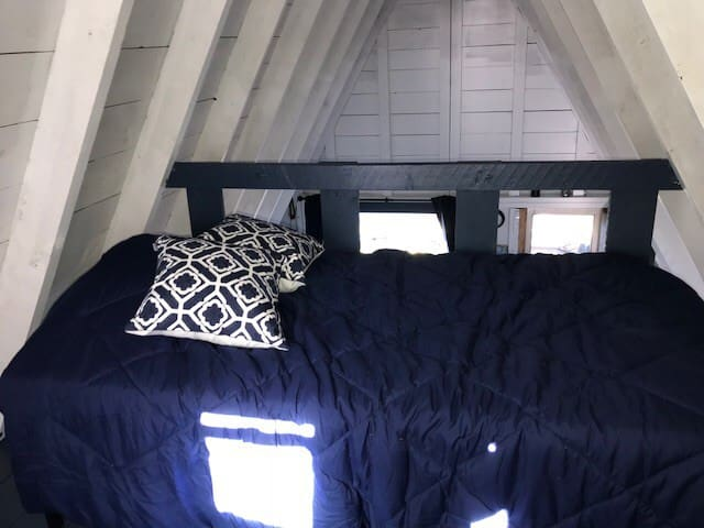 Twin bed up in loft.