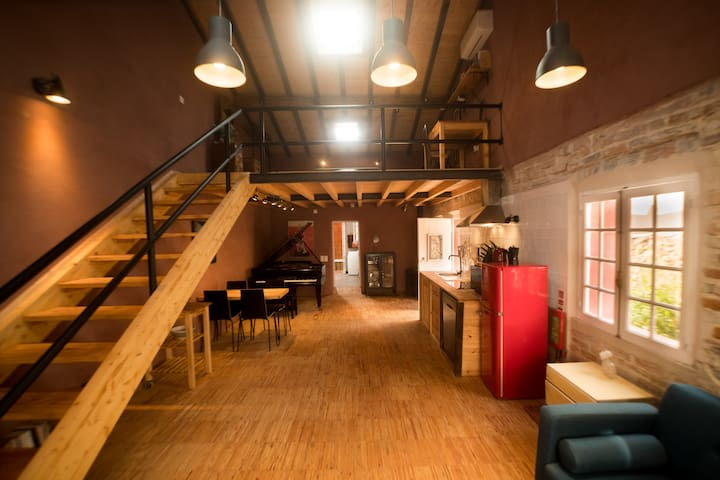Charming loft retreat in historical house