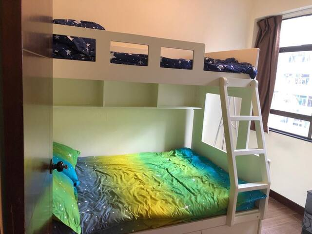 lower level is standard double bed for 2 person and upper level is single bed for one person