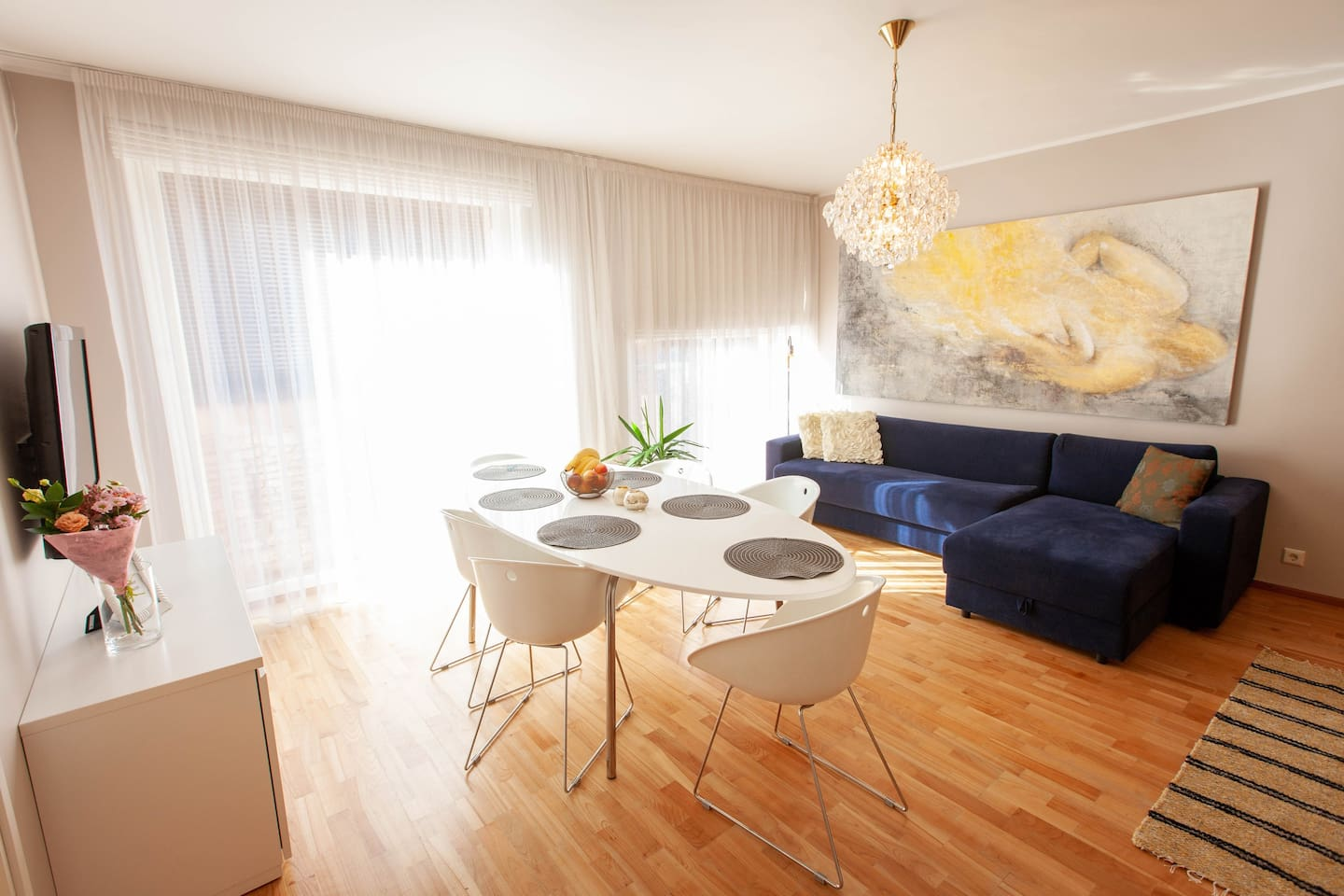 Living room has cosy coach and big table for work, dining or just spending time with your mates.