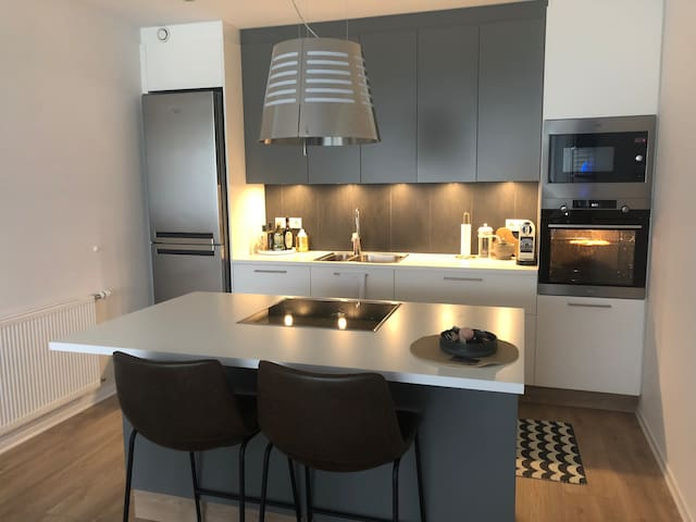 BRAND NEW apartment near the ocean and city center