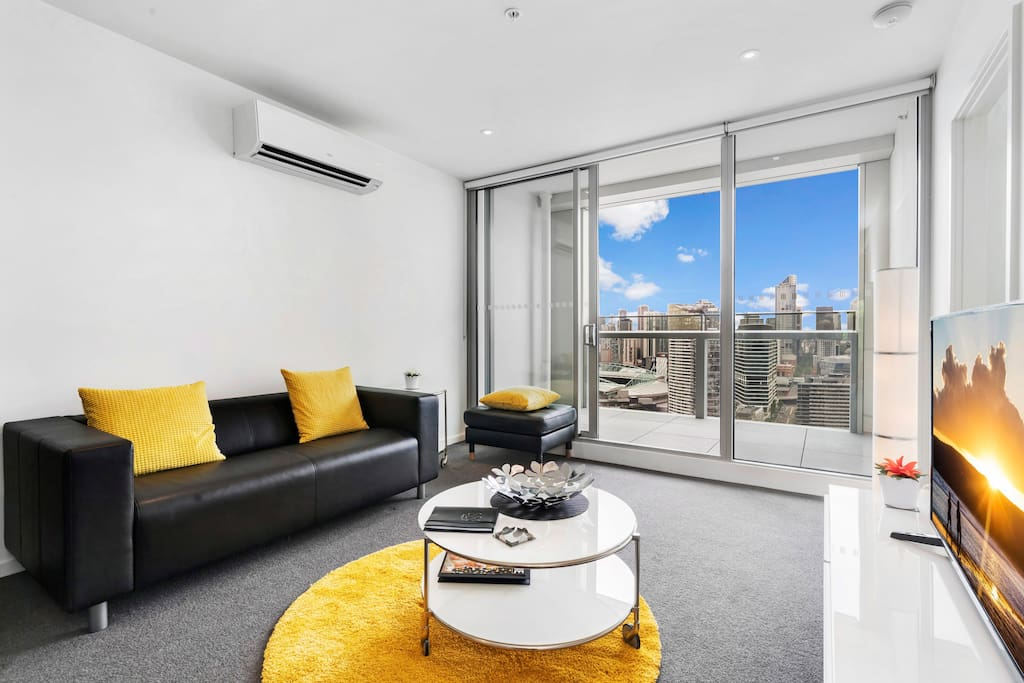 Sophisticated Living Room with Stunning Views of Docklands