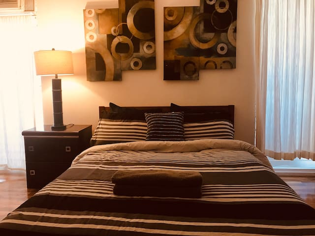 One Master bed with private bathroom- free parking