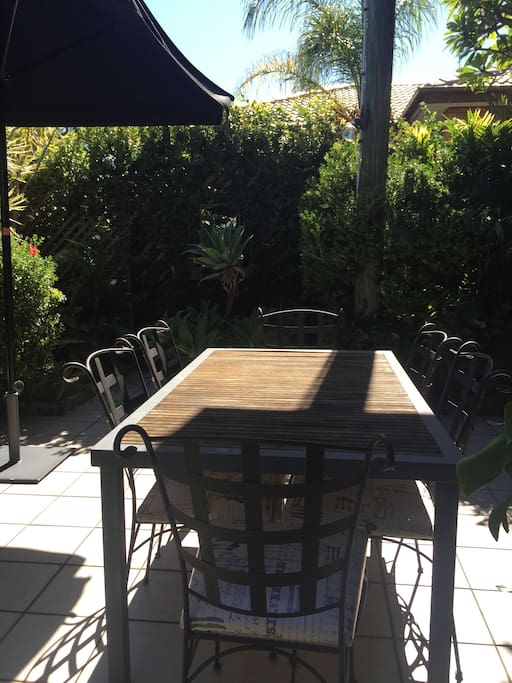 Exclusive use of courtyard with established tropical plants. With BBQ and outdoor setting
