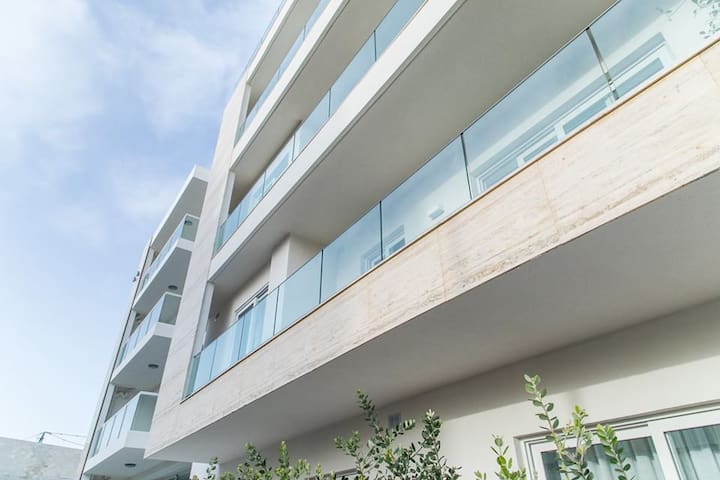 Our apartments are brand new - they have a lovely 14 meter frontage on a quiet street. Smoking is only allowed on the terrace.