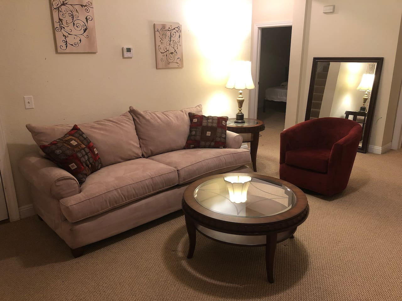 """The Living Room, with a 50"""" TV, has plenty of seating with two additional chairs and a couch!"""