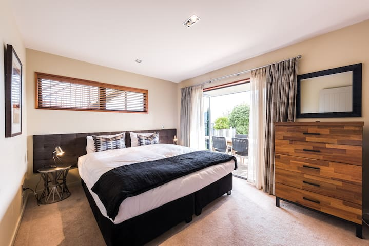 The 3rd bedroom with a king bed that can also be be two singles.  This room has a door onto the garden and to the hot-tub.