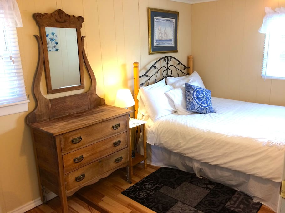 comfortable queen bed, quality fresh linens, iron and ironing board, spacious closet, room darkening blinds