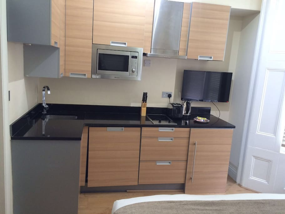 Fully equipped kitchen with microwave and cutlery and 32 inches Plasma TV.