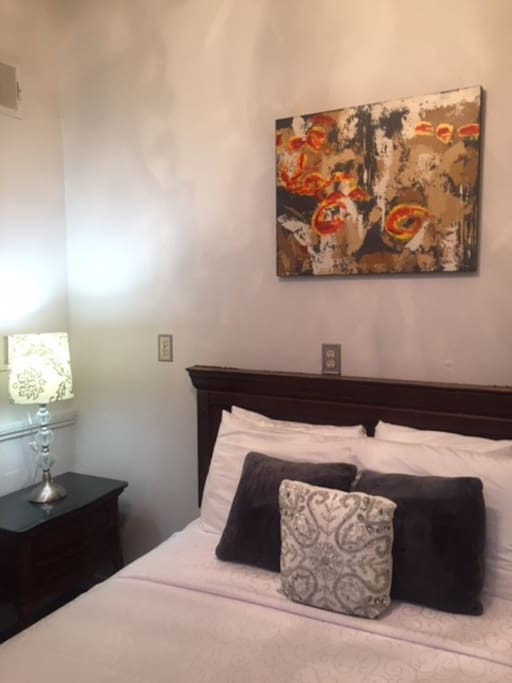 This cozy room is ideal for backpackers, or travelers that need an affordable place to stay.  There is a table and chairs not pictured.