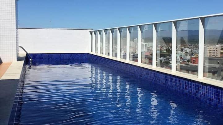 Flat com piscina e próximo ao mar em Torres