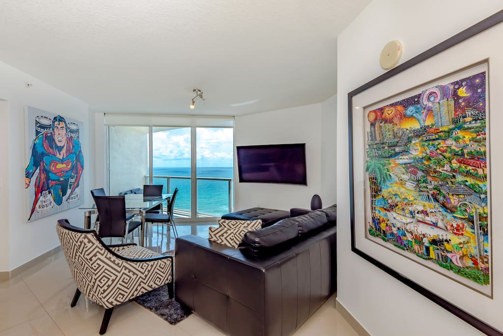 Modern decor throughout with amazing ocean views! Spacious layout with oceanfront dining :)
