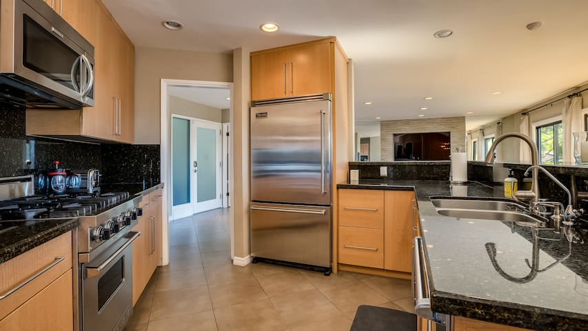 The kitchen is complete with Viking appliances and all of your kitchen necessities.