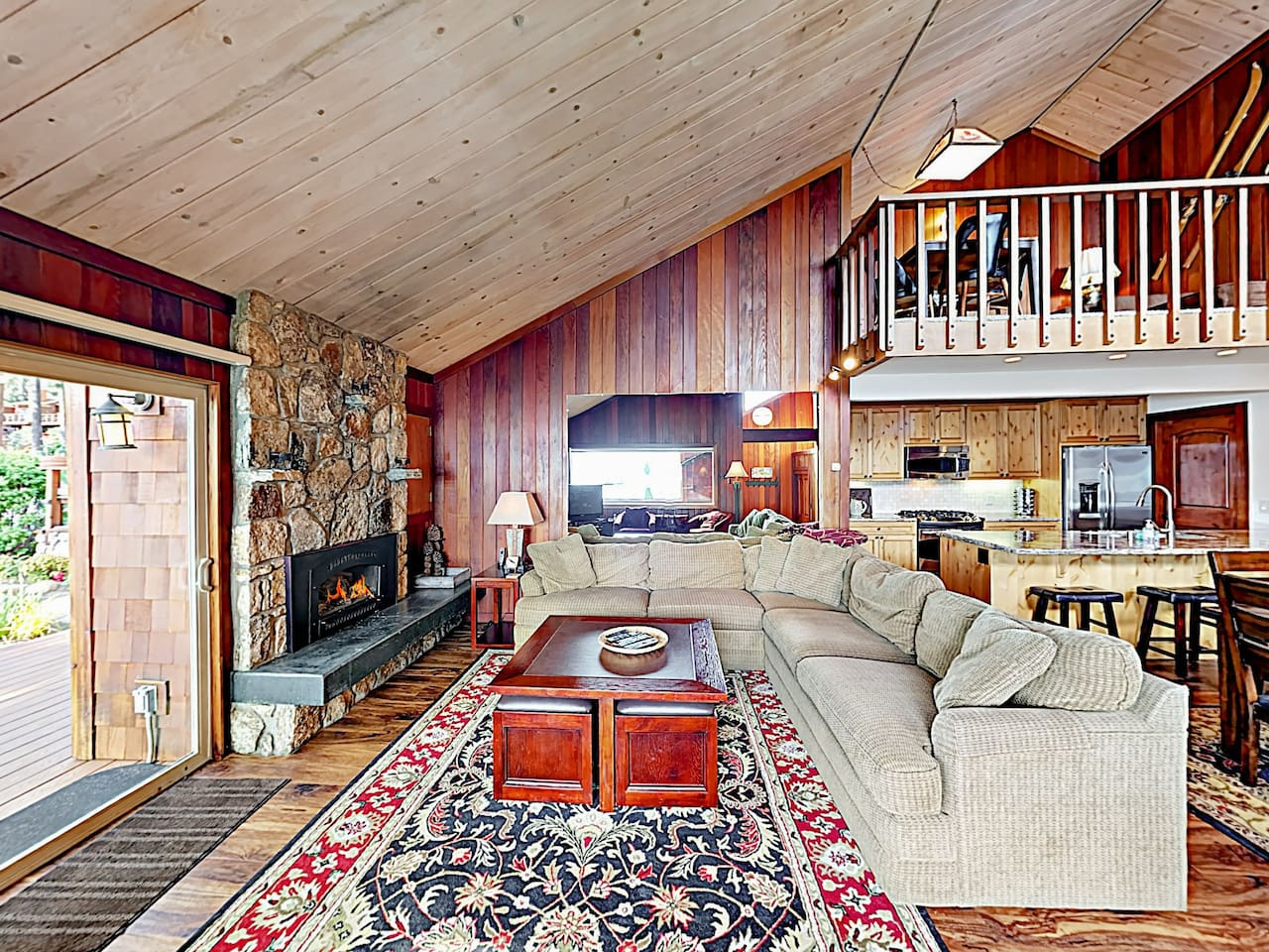 Welcome to Kings Beach! Your rental is professionally managed by TurnKey Vacation Rentals. Warm wood details glow from floor to ceiling throughout the spacious interior.