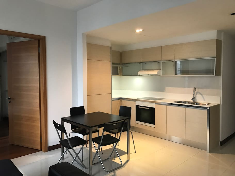 Open kitchenette with oven , dining area