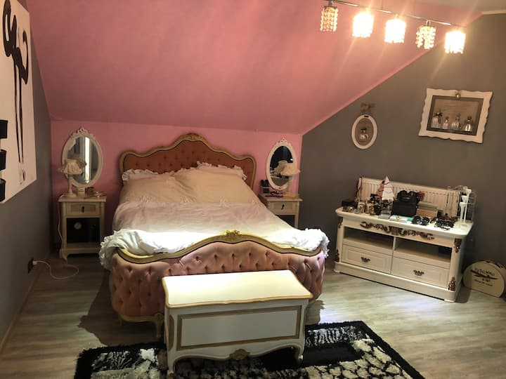 Pink room with private bathroom