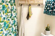 a spot to hang your suits in the Master bathroom