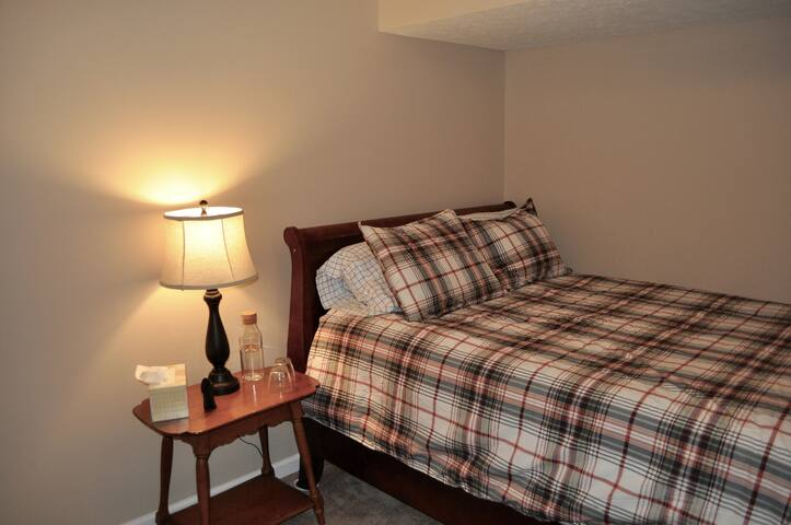 The Spruce Room has a queen bed and is on the lower level. It does not have windows -- perfect for light-sensitive sleepers.