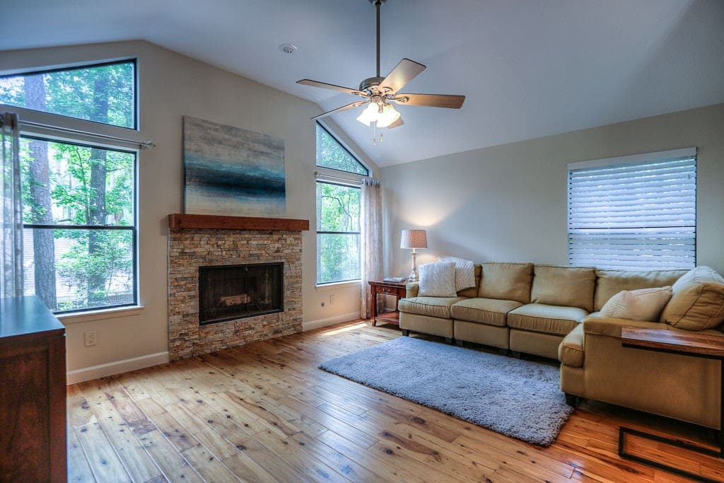 This home is nestled in one of the most popular Villages in The Woodlands, Grogan's Mill surrounded by trees.