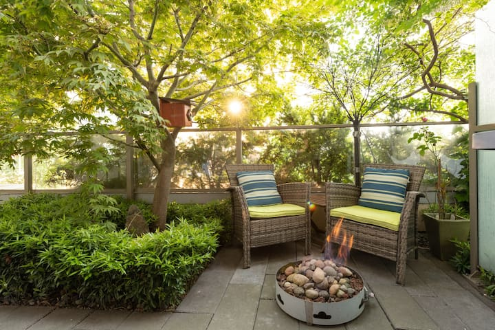 Private garden patio with fire pit