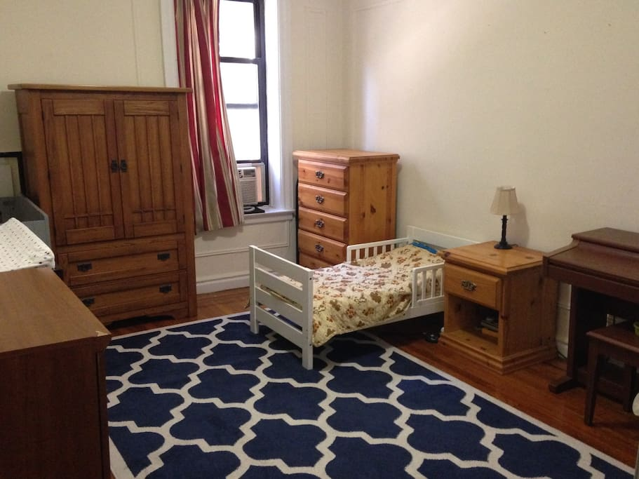 Large bedroom easily accommodates our queen size air mattress and/or kids in toddler bed and crib.  Also: electric piano