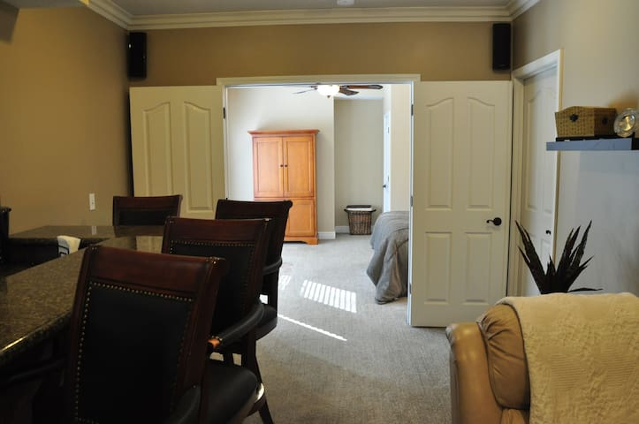 Living area looking into the bedroom with double doors - provides privacy