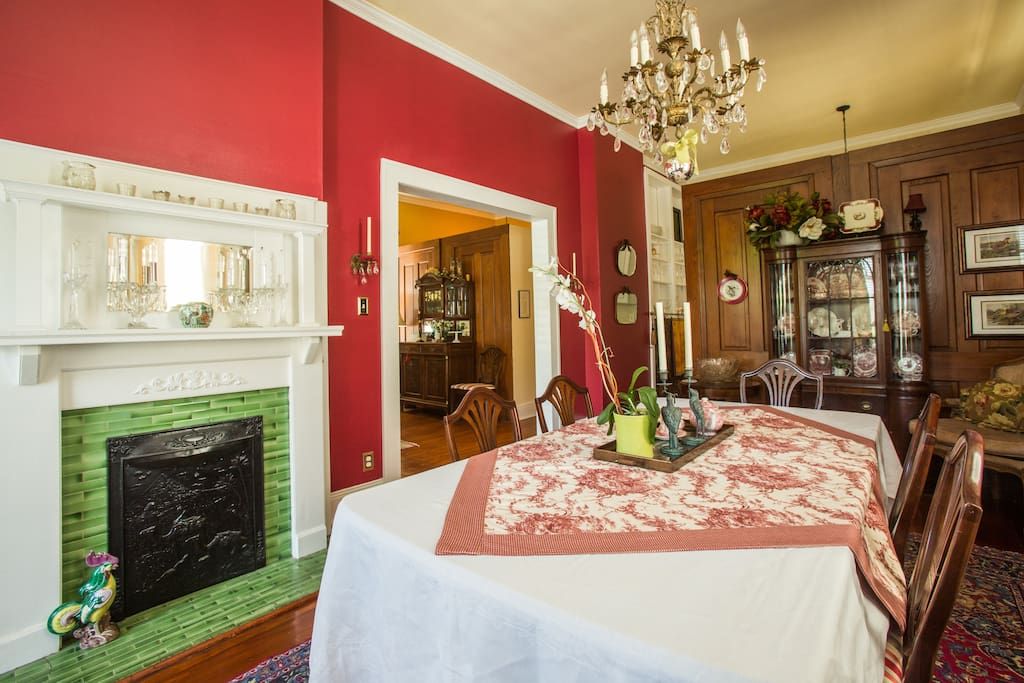 The archway to the right of the fireplace in the dining room is the owner's side of this traditional double.