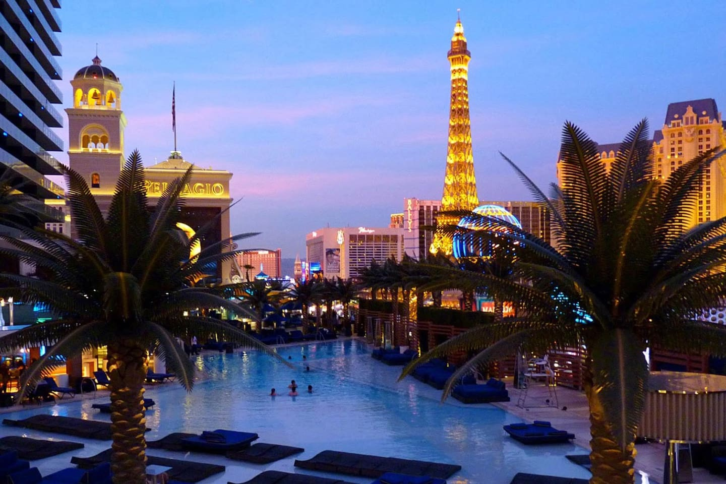 A view from the Cosmopolitan Bamboo pool (free use with the room key) looking directly overtop of the Jockey club at the belagio on the left,  Paris and Planet Hollywood on the right