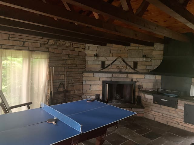 ***Pool table underneath table tennis conversion top. Stone room features second entrance and a sliding door leading to kitchen.
