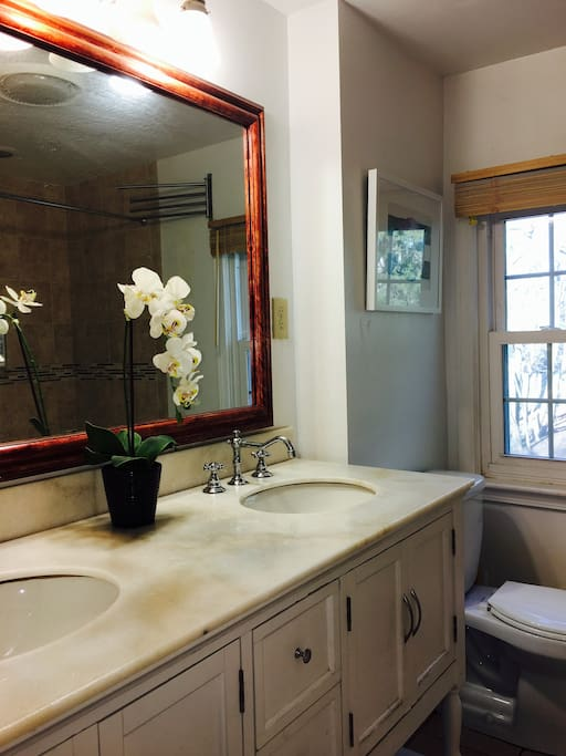 Full bath upstairs, with marble top vanity.