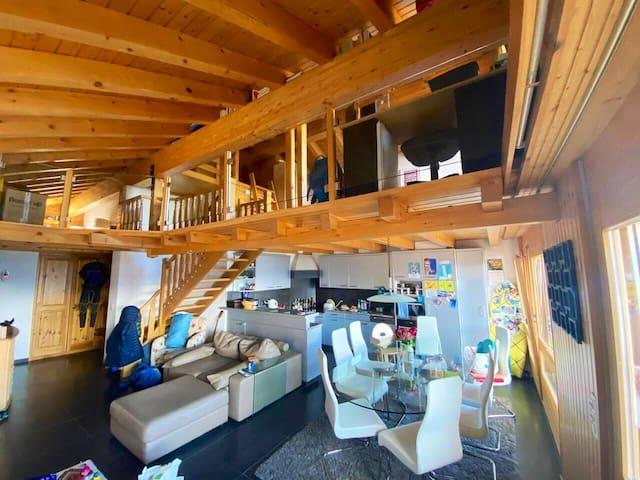 Main living area with mezzanine with two double bedrooms. A great open space downstairs and up.