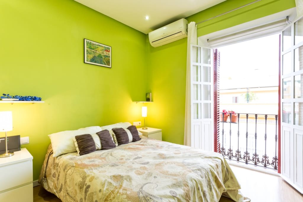 Comfortable bed and balcony with wonderful views.