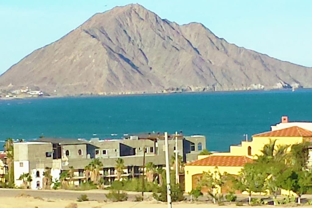 WALK TO THE SEA OF CORTEZ AND THE MARINA from this 2 BR fully furnished, spacious 1100 sq. ft. home, just less than 2 miles south of town where you will find finer & better beaches. Experience the tranquil setting from your balcony and deck with rejuvenating sea breeze and country air.