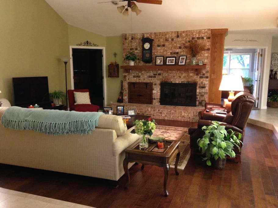 Living room complete with cozy blankets, recliners, and TV with blu-ray and DVD player. Perfect for resting after a long day playing around town.