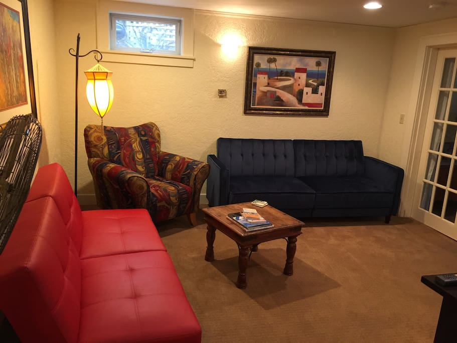 Comfortable living room with two fold down couches for extra sleeping options in addition to the queen bed in bedroom and full bed in sleeping cubby.