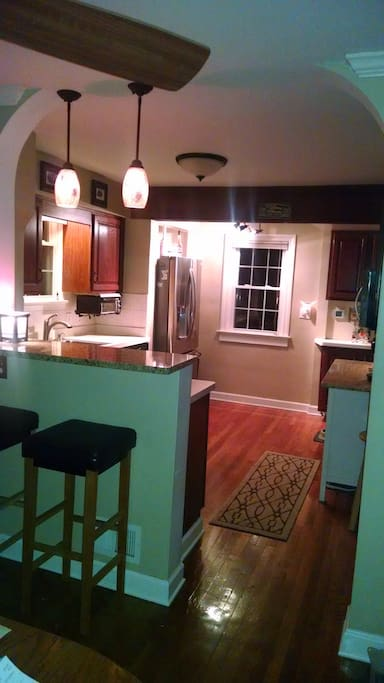 Open kitchen with breakfast bar & stainless steel appliances