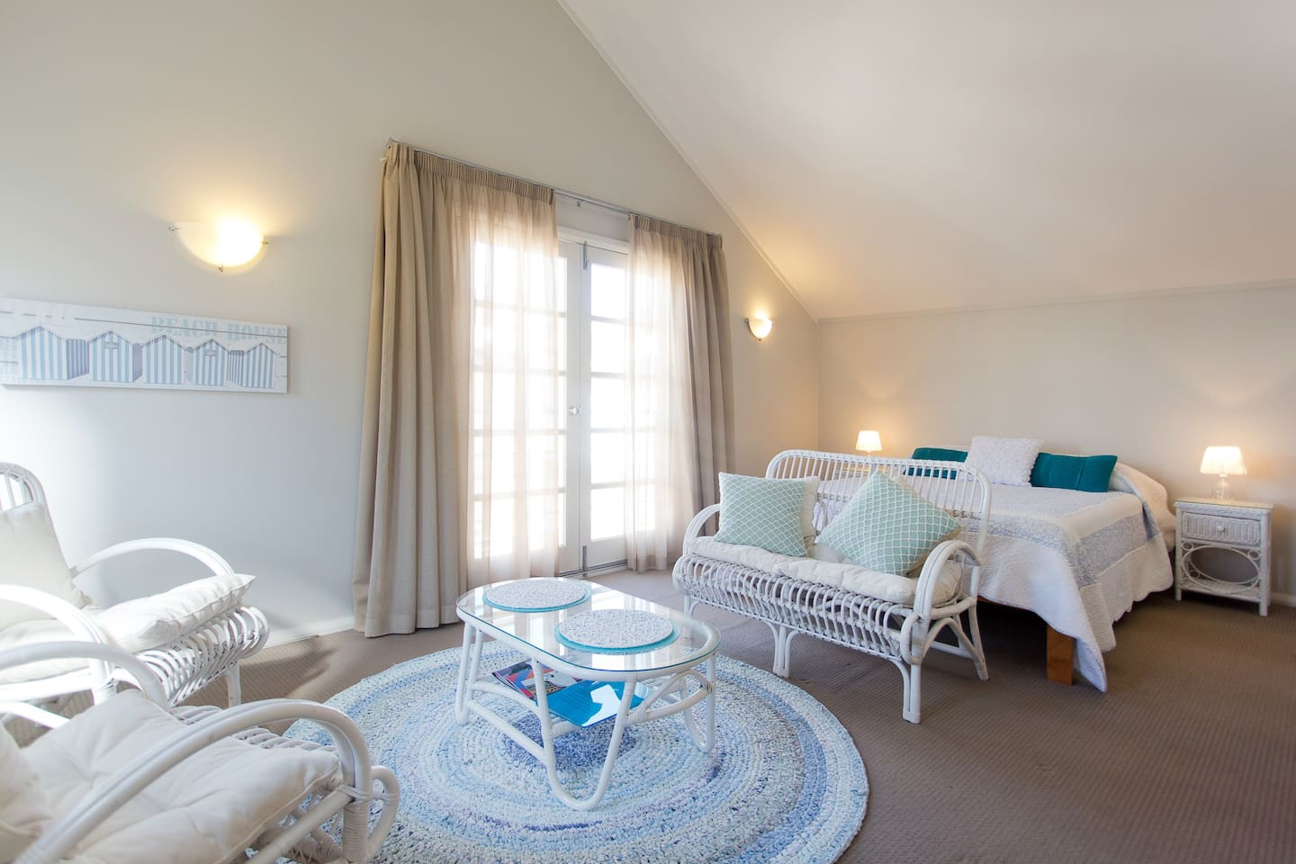 Fremantle local beach studio:Light and bright living area with French Juliet doors opening to local street.