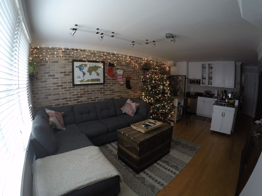 Cozy brick wall, large couch for ample seating