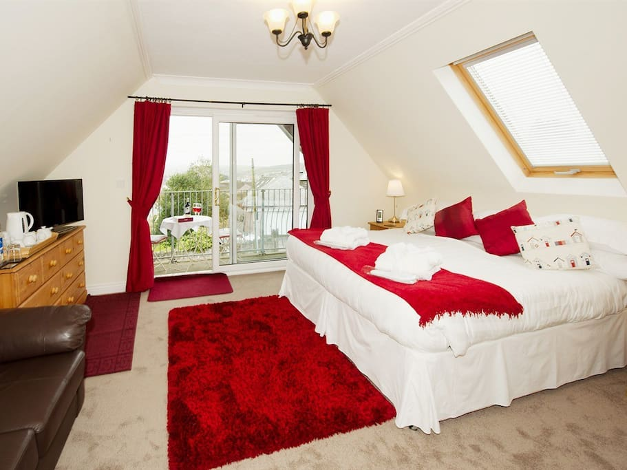 Polzeath room shown with super king double bed. Polzeath room has a balcony with views across Wadebridge