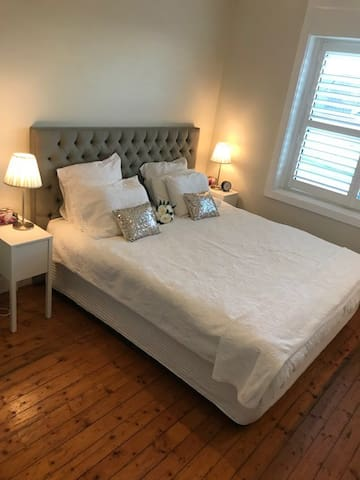Queen size comfortable bed in a beautiful clean room