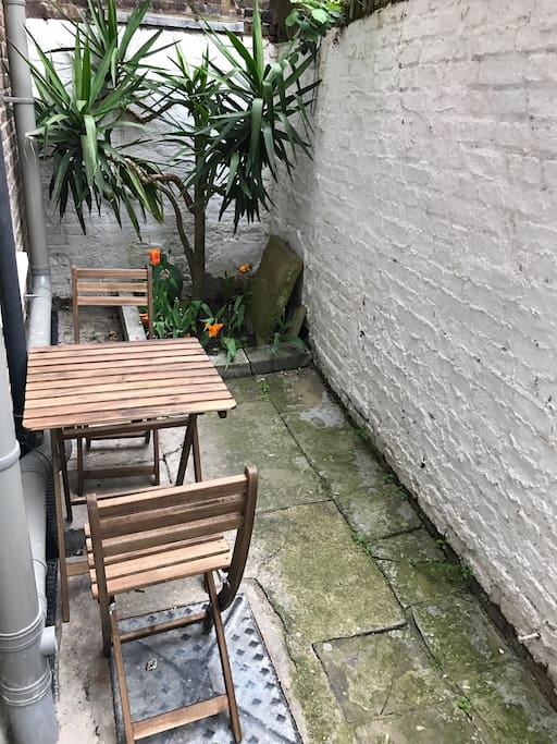 Private rear courtyard garden. I've added a bigger garden table since this was taken.