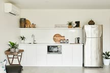 Kitchenette , comprising of bench, storage, sink, microwave and fridge. There is an electric frying pan provided for cooking. A BBQ is outside for your use. There is no stove or hotplates.