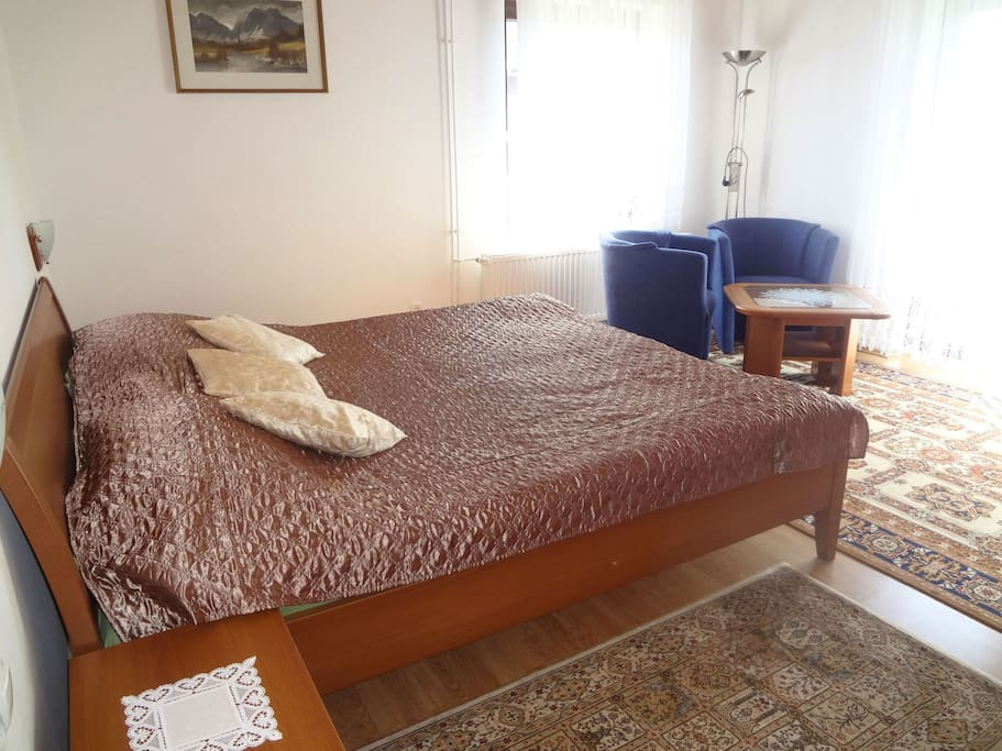 A king size bed in the first bedroom.